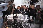 Energy Secretary Steven Chu looks over the four cy