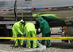 A tanker truck dispenses caustic into C-104, the third of three tanks now in the process of active solid waste retrieval.