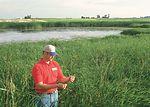 NRCS District Conservationist Dan Paulsen inspects