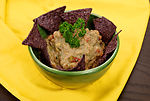 Garnished with a sprig of parsley, this image depi