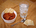 Here we have a bowl of beef chili and crackers, an