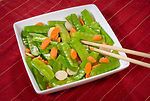 This image depicts a dish of Asian Snow Peas, the