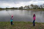 Girls pose while fishing