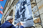 Secretary Kerry Signs Posted of Famed Vaccaro Photo in Saint Briac