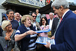 Brittany Resident Hands Secretary Kerry a Scrapbook She Has Been Keeping of His Career
