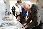 Secretary Kerry, Mayor Denby-Wilkes, Photographer Vaccaro Sign Posters of Famed WWII Picture