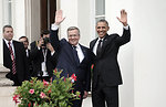 President Obama and Polish President Komorowski Wave at the Belweder Palace