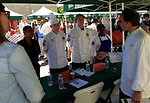 Chef Eric Ziebold gives feedback to the military chef competitors