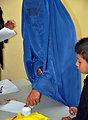 An Afghan woman wearing a burqa inks her finger at a polling center in Kabul.