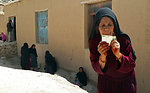 An elderly woman posing for a photo after casting her vote in Daikundi province.