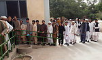 Voters queuing up in front of a polling center in western Herat province.