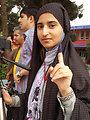 A female journalist displays her inked finger after casting her vote in Afghanistan's western Herat province.