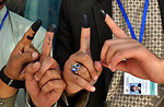 Voters disaply thier inked fingers afte casting thier votes at a polling station in Kabul.