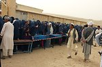 Women wait to vote near a polling center in northern Samangan province.