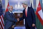Secretary Kerry Shakes Hands With Omani Foreign Minister Yusuf bin Alawi bin Abdullah