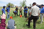 Groundwork Denver Members Demonstrate How to Plant Cottonwood Trees