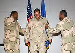 Iraqi airmen tack on master sergeant's stripes