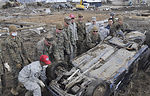 Airmen help with tsunami cleanup