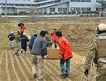HH-60s deliver supplies to decimated Kessenuma City