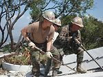 Air Force firefighters in Haiti dig through rubble, protect airfield resources