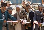 Reconstruction team dedicates water well