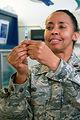 Maj. Paula Pino prepares to administer a flu shot