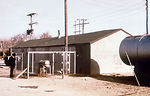 This 1975 photograph shows a well, a pump, and a l