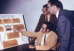 This 1971 photograph shows system analysts discuss
