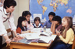 This photograph shows a teacher instructing childr
