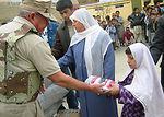 Flag-flying donations warm American hearts, Afghan feet