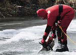 Firefighters train in icy lake