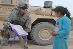 Service members give gifts to children