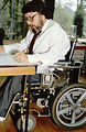 Seated in his wheelchair at his accessibility-enha