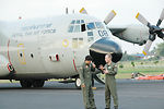 Lt. Col. James Banker discusses aerial firefighting with Royal Thai Air Force Squadron Leader