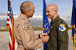 Father pins Distinguished Flying Cross on son