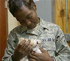 Airmen rescue kittens inside wall