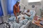 NCAA coaches visit troops in military hospital