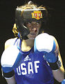 Female Airman tosses hat in boxing ring