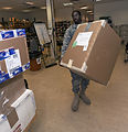Postal workers deliver pieces of home through mail