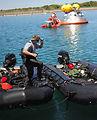 Pararescuemen conduct water test of new NASA capsule