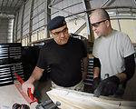 Airmen teach Iraqi air force members aircraft maintenance