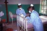 Two Zairian nurses wear protective clothing while