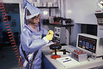 A CDC scientist conducts laboratory research in th