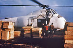 This late 1960s photograph depicts a helicopter, w