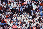 This 1980's photograph shows a crowd of healthcare