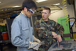 JASDF personnel learn aircraft battle damage repair