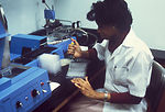Here a laboratory technician is preparing material