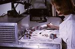 A CDC laboratory technician is shown here sorting,