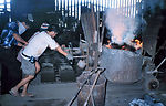 This photograph shows individuals within a foundry