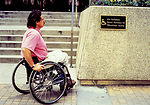 The wheelchair-seated man depicted in this photogr
